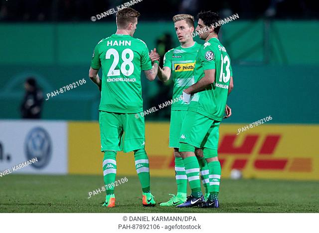 Gladbacher's players Andre Hahn (l-r), Patrick Herrmann and Lars Stindl celebrate their win in the round of sixteen DFB Cup match between SpVgg Greuther Fuerth...
