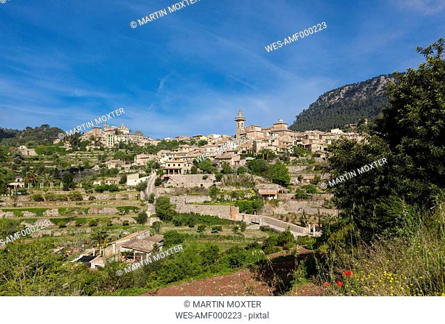 Spain, Mallorca, View of Parish church of Sant Bartomeu at old town of Valldemossa