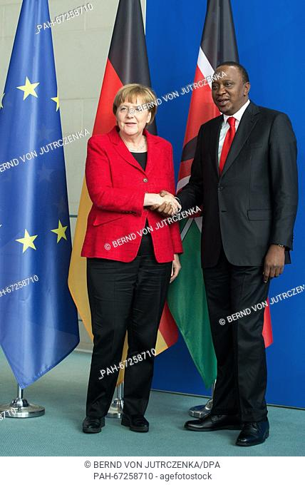 German Chancellor Angela Merkel (L) and Kenya's President Uhuru Muigai Kenyatta shake hands at a press conference following talks at the Federal Chancellery in...