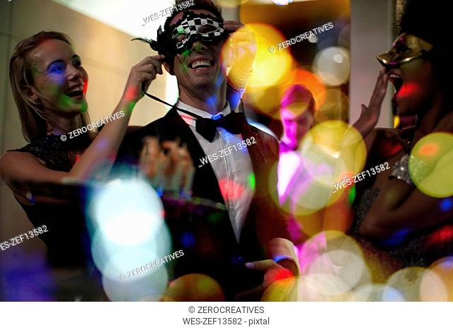 People celebrating and having fun on a costume party