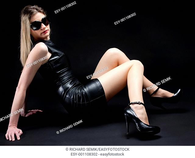 sitting woman wearing black dress and shoes