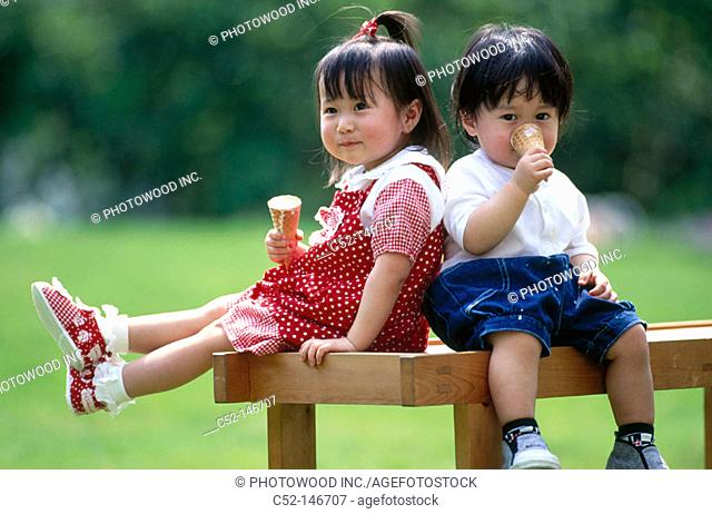 Asian children eating ice-cream