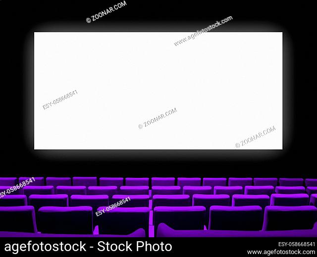 Cinema movie theatre with purple velvet seats and a blank white screen. Copy space background