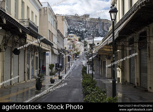 17 February 2021, Greece, Athen: The shutters of the shops in Athens' Monastiraki district are closed. A strict lockdown has been in effect for the greater...