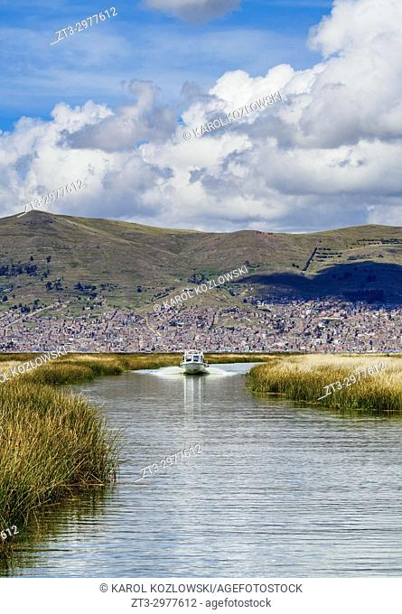 Boat going from Puno to Uros Floating Islands, Lake Titicaca, Puno Region, Peru