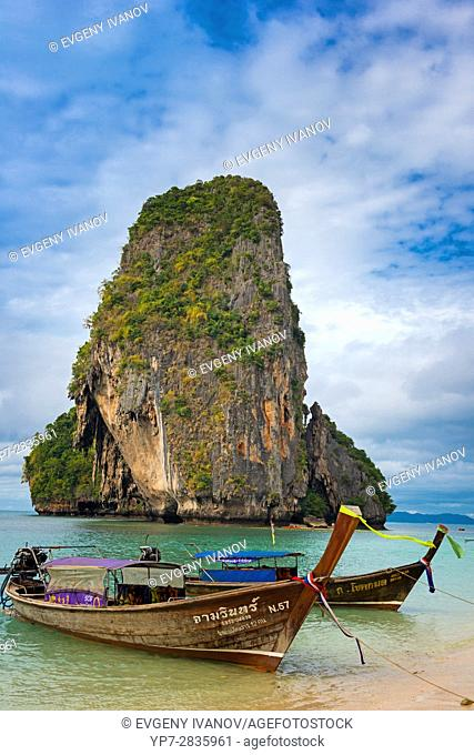 Rock and longtail boat near Phra Nang beach in Krabi, Thailand