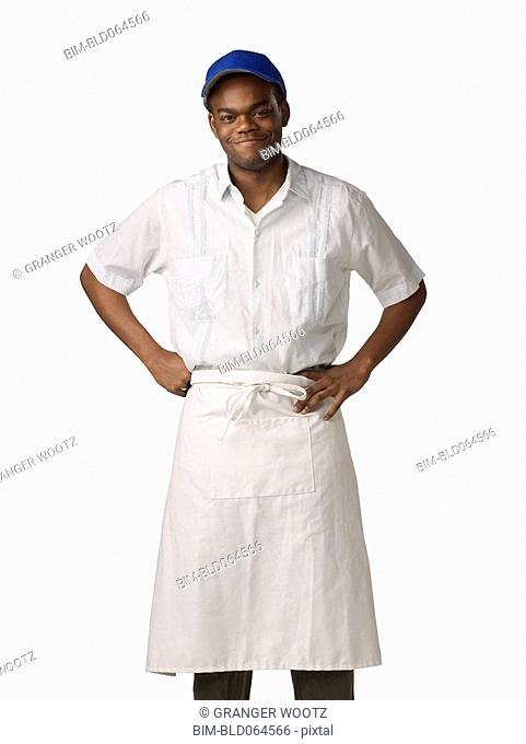 African man wearing cook's uniform