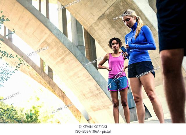 Joggers taking break on bridge, Arroyo Seco Park, Pasadena, California, USA