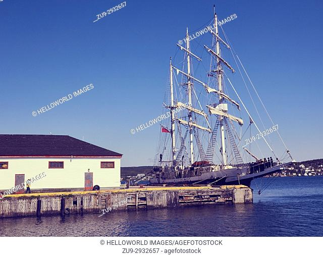 Sailing ship Lord Nelson moored in harbour, St Anthony, Newfoundland, Canada. . Operated by the Jubilee Sailing Trust to allow disabled and able bodied chance...