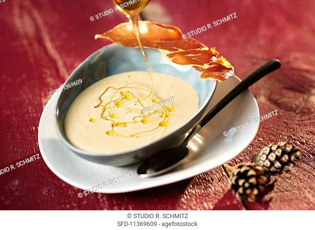 Chestnut and orange soup with a Parma ham crisp and honey