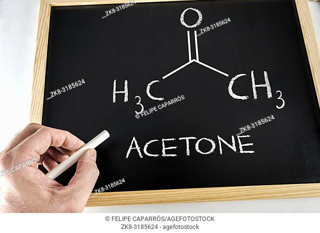 Written to hand with chalk in a slate it formulates of the acetone