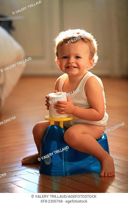 Karl, 2 years old sat on his chamber pot