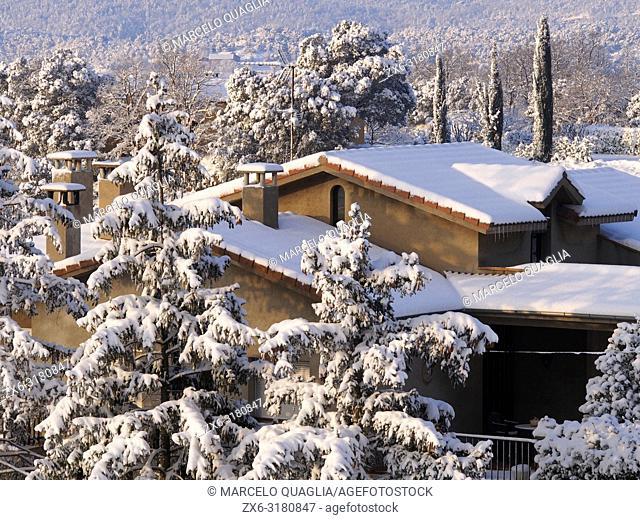 Winter morning at Santa Eulàlia village countryside after night snowstorm. Lluçanès region, Barcelona province, Catalonia, Spain.