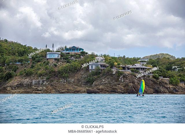 The Caribbean sea and a tourist resort seen from a boat tour in a cloudy day Antigua and Barbuda Leeward Islands West Indies