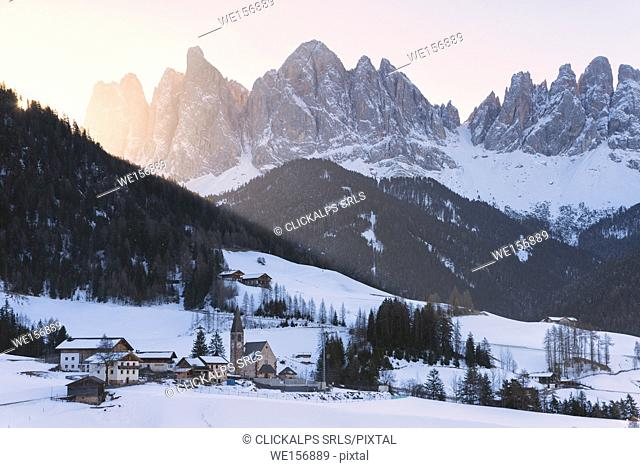Sankt Magdalena in a winter sunrise in Funes valley, Odle Natural park in Trentino Alto Adige district, Italy, Bolzano province, Europe