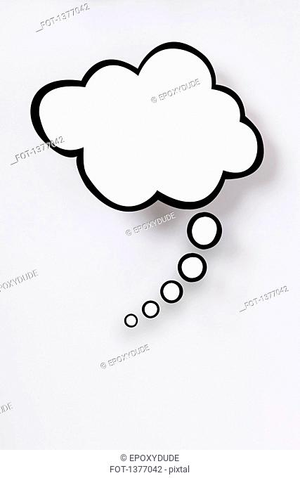 Blank thought bubble against gray background