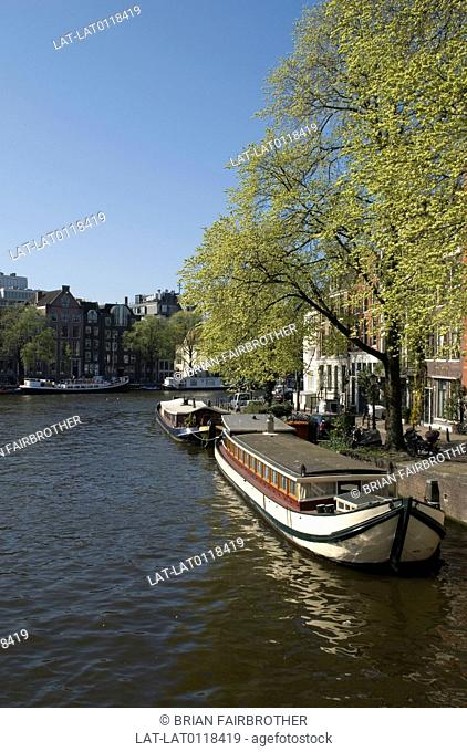 The Zwanenburgwal canal is in the centre of Amsterdam,looking southwards it joins the Amstel