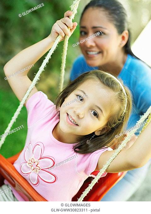Close-up of a girl on a swing