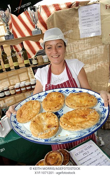 A woman selling R K Palfrey's home made meat pies at the Abergavenny food festival, Monmouthshire south wales UK  September 19 2009