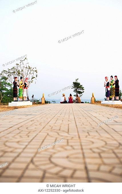 Relaxing atop the hilltop stupa; Luang Namtha, Laos