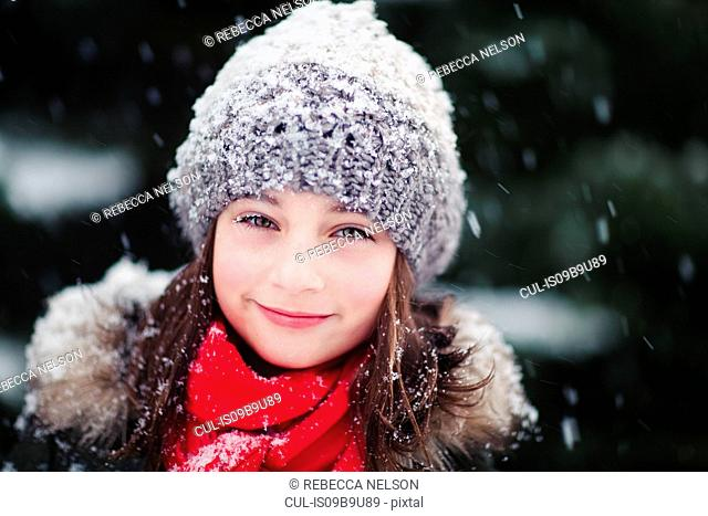 Portrait of girl in falling snow