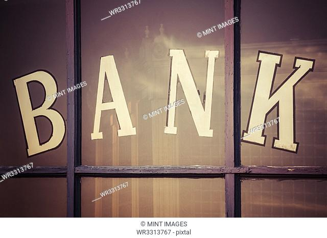 "Close up of """"bank"""" written on window panes"