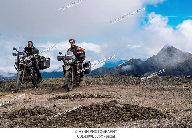 Couple on touring motorbikes at the pass of Abra de Malaga (4316 m.s.n.m.), Cusco, Peru, South America