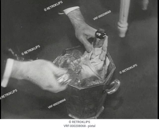 Medium shot of hands opening champagne bottles
