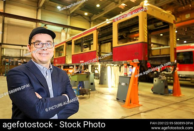 22 January 2020, Saxony-Anhalt, Halle: Peter Buchner, managing director of S-Bahn-Berlin, is standing in front of a class 481 car in a hall of the Maschinenbau...