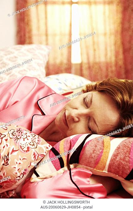 Close-up of a mature woman sleeping on the bed