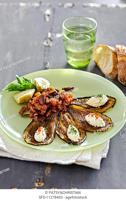 Aubergine and tomato salad with goat's cream cheese