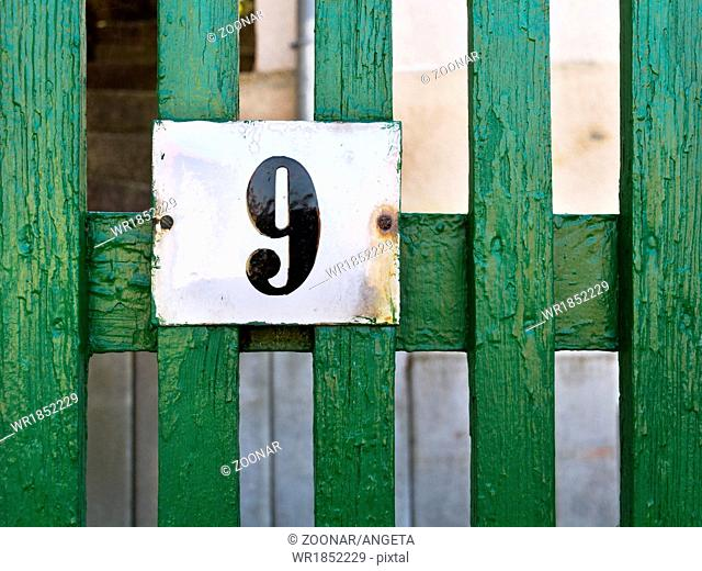 wooden fence with number