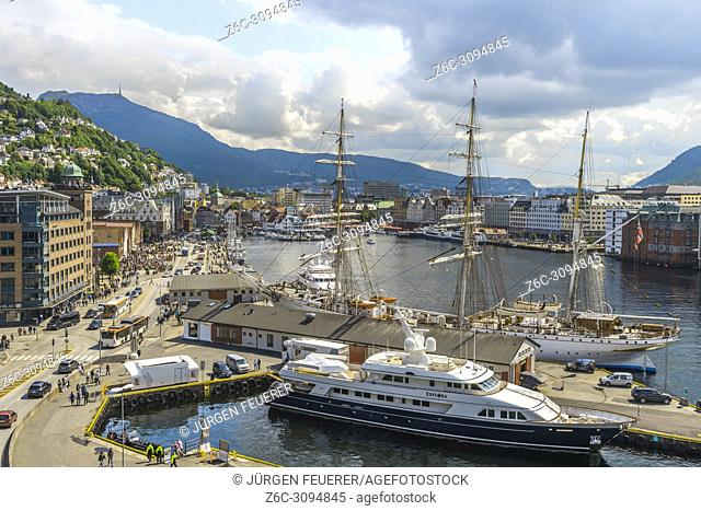 panorama view of city centre Bergen, Norway, Bryggen, the city centre and Mount Ulriken with tower, harbour with sailing boat and yacht
