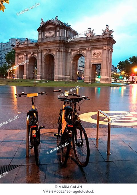 Bike parking at Independencia Square and Alcala Gate, night view. Madrid, Spain