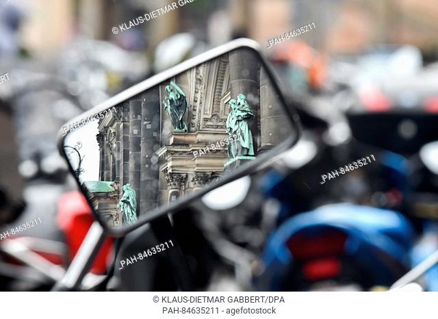 The facade of the Berlin Cathedral as seen in the wing mirror of a motorbike parked in front of the building in Berlin, Germany, 09 October 2016
