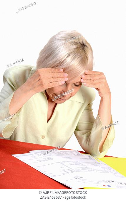 Frustrated woman looking at tax forms