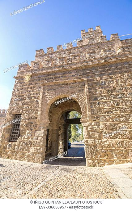 facade of ancient building Alfonso VI Gate, landmark and ancient age monument from tenth century, one of the pedestrian public access to Toledo city, Spain