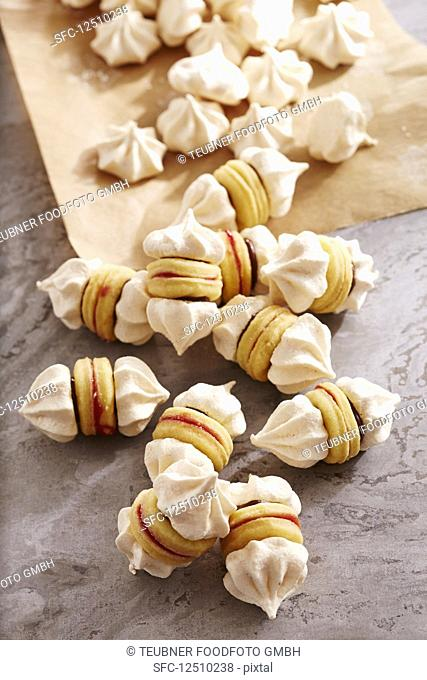 Meringue biscuits with shortbread bases, chocolate spread and redcurrants