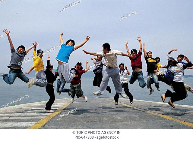 Group of Young People Jumping in the Air Outdoor, Korea