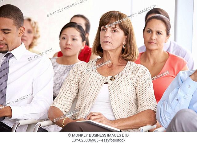 Business Delegates Listening To Presentation At Conference