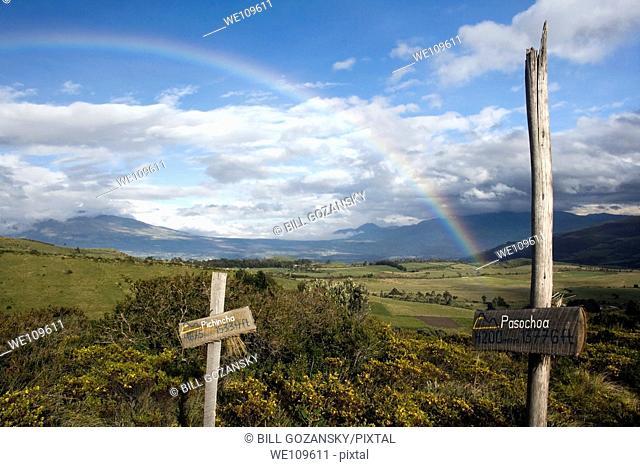Trail signs and rainbow - near Hacienda El Porvenir - Cotopaxi, Ecuador