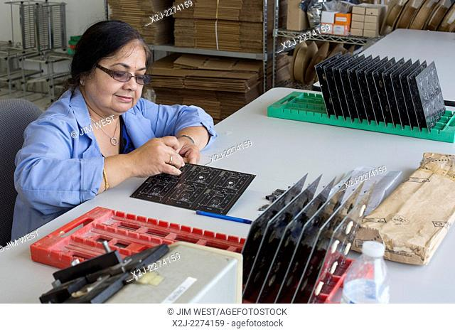 Detroit, Michigan - A worker for A123 Systems assembles circuit board for unmanned aerial vehicles (drones) manufactured by Detroit Aircraft Corporation
