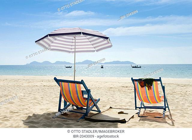 Sun loungers and parasols on the sandy beach, Farang Beach, Ko Muk or Ko Mook island, Thailand, Southeast Asia