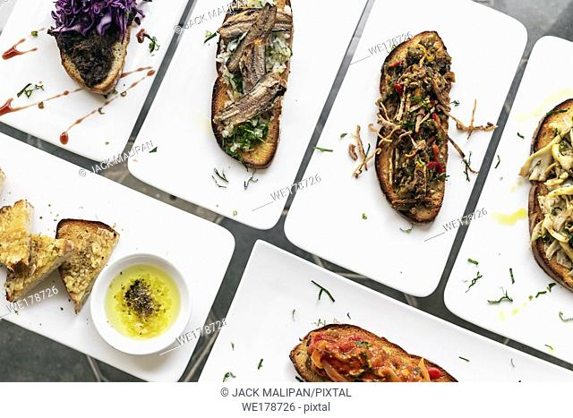portuguese traditional tiborna toasted open sandwich tapas snacks on table