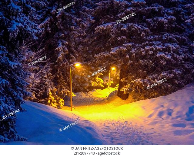 enlightened snow path at night in Flaine, France