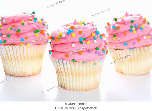 shot of Three cupcakes with sprinkles