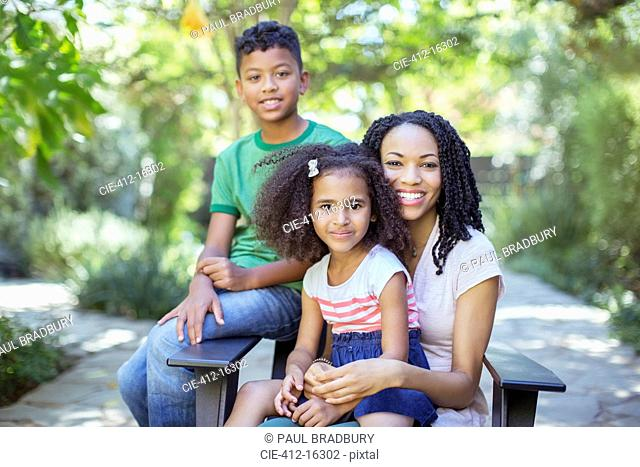 Portrait of smiling mother and children outdoors