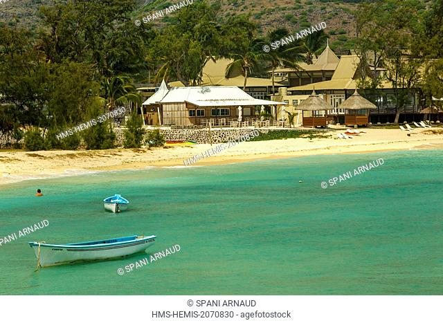Mauritius, Rodrigues Island, Pointe Coton, horizontal view of a luxury beachfront hotel and fishing boats in a cove of a blue lagoon