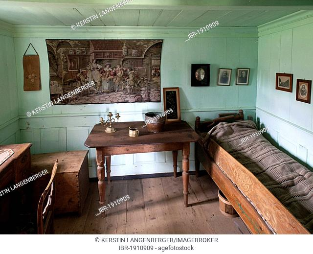 Interior of an old sod house in the museum Skógar, Iceland, Europe