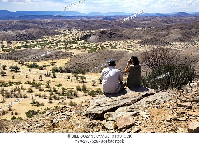 Couple overlooking Huab River in Damaraland - Huab Under Canvas, Damaraland, Namibia, Africa